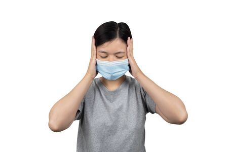 asian women wearing protection medical masks having a headache isolated white background Reklamní fotografie