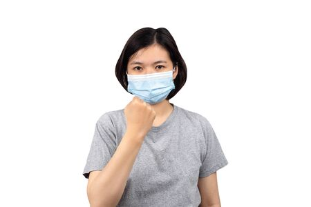asian women wearing protection medical masks and raising fists,ready to fight corona virus  isolated on white background