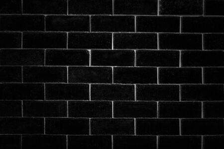 close up grunge black brick wall textured baground