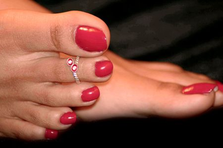 black toes: Picture of red nail polish