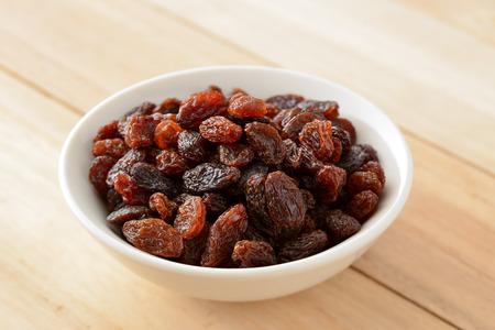 Raisins on wooden background Stock Photo - 84544715