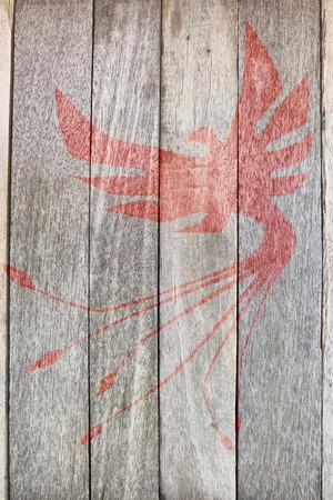 phoenix bird on wood background photo