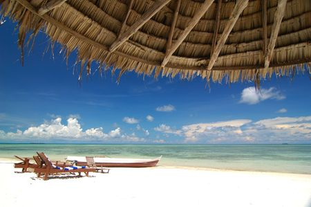 Tropical beach resort with bamboo hut in the foreground Stock Photo - 6839980