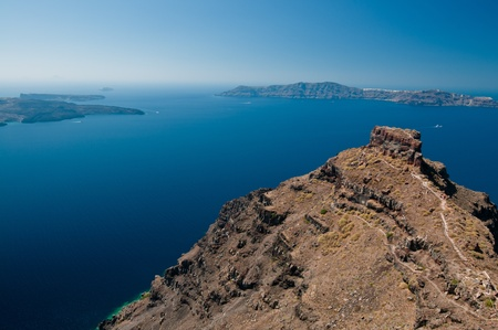Agean sea view from Santorini island with hill and walking track in the foreground Stock Photo