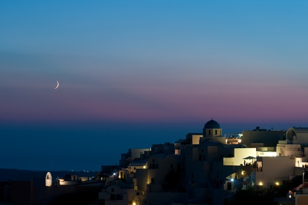 Oia of Santorini after sunset with moo Stock Photo