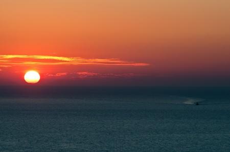 Sunset at Oia of Santorini photo