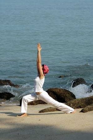 hatha: virabhadrasana, hatha yoga by the beach