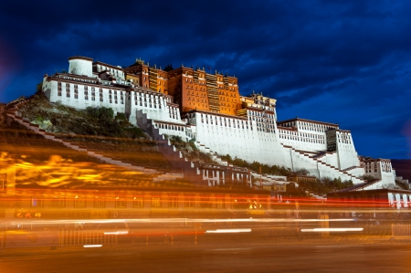 Potala palace in Tibet, China. Photo taken in after sunset, long exposure to capture the light trails of passing vehicle