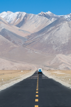 Long road ahead with mountain in front, Tibet, China. photo