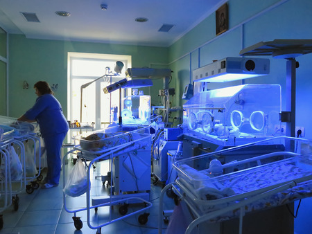 paediatrics: Odessa, Ukraine - October 9, 2014: Obstetrics and Gynecology Hospital. Newborn babies born to mothers who suffered from jaundice. Doctors provide children in the incubators under the blue light UV light to treat children and recover from the disease with  Editorial
