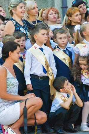 traditionally russian: Odessa, Ukraine - September 1, 2015: elementary school students stand on the first day of the school year. Feast Day of Knowledge. Beginning of a new academic year.