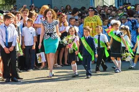 Odessa, Ukraine - September 1, 2015: primary school children with teachers and parents on the first day of the school year. Feast Day of Knowledge. Classes start the new school year. Editorial
