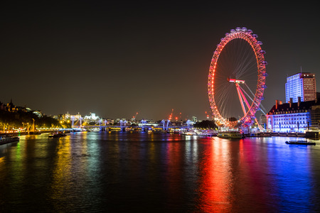 millennium wheel: The night cityscape view of London Eye and River Thames