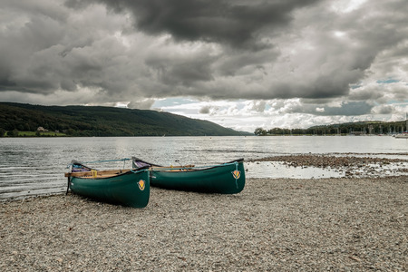 lake district england: Two rowing boats with the overcast day at Coniston in Lake District, England Stock Photo