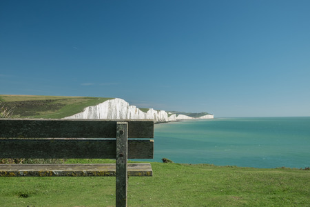 seven sisters: Wooden bench with the view of Seven Sisters cliffs Stock Photo