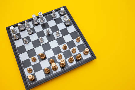 Close up shot of chess board isolated on yellow