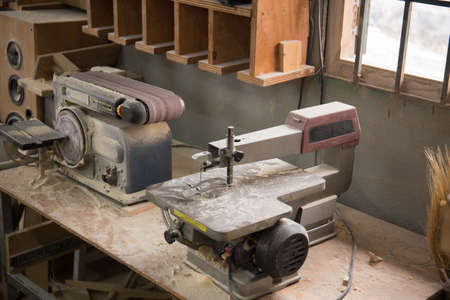 Photo of grinding machine and electric jigsaw machine in a workshop