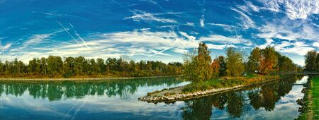 The river Mangfall flows into the River Inn, Panorama of landscape, near Rosenheim in Upper Bavaria, trees in autumn colors on the banks Stock fotó