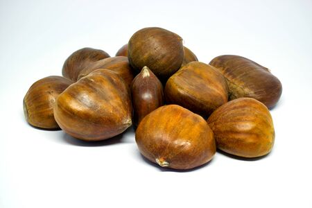 Several whole chestnuts, isolated on white background Stock Photo - 133157342