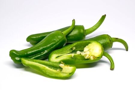 Four jalapeno peppers (one of which is cut open), isolated on white background, macro with focus stacking Imagens