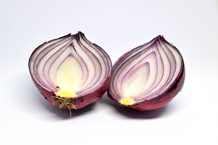 A red onion, cut in half, isolated on white background