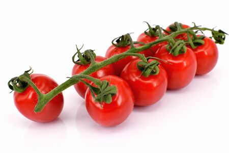 A panicle of red cherry tomatoes, isolated on white background, macro with focus stacking Archivio Fotografico