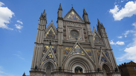view of the cathedral of Orvieto on a sunny summer day