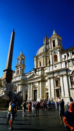 Rome - September 23, 2018: Church of Sant'Agnese in Agone in Piazza Navona with tourists strolling in the square