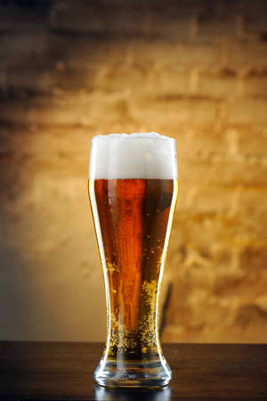 Beer into glass on a old stone Stock Photo - 12867218