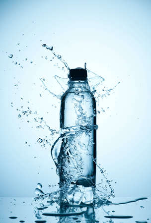 bottle with water: Bottles with mineral water and splash around it