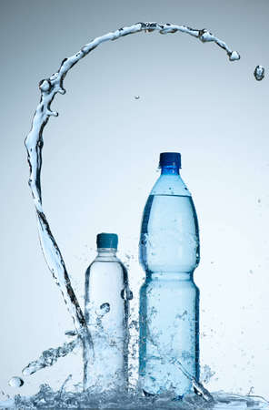 Bottles with mineral water and splash around it photo