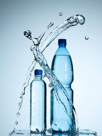 Bottles with mineral water and splash around it Stock Photo - 13101046