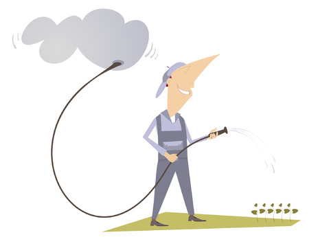 grass plot: Man is watering a lawn with hose