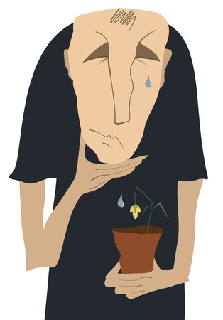 Sad man sheds tears on the wilted flower