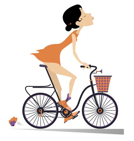Pretty young woman rides a bike isolated. Smiling young woman rides a bike and looks healthy and happy