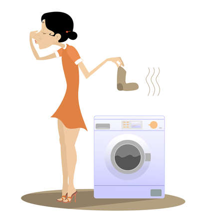 Woman is going to wash dirty laundry in the washing machine. Young woman stands near washing machine holds her nose from dirty laundry odor nuisance isolated on white