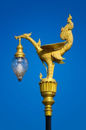 Thai legendary swan gold electricity post or lamp photo
