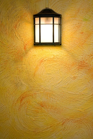 Classic dark brown lamp on yellow abstract wall photo