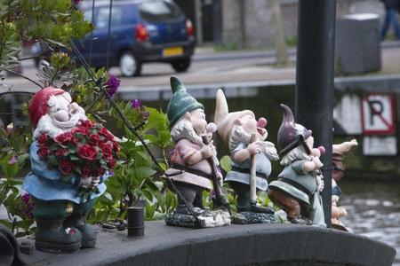 gartenanlage: Garden gnomes on the boat Stock Photo