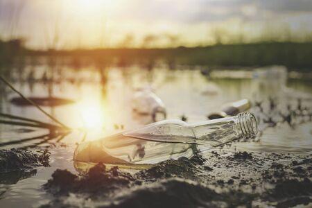 Bottle in the lake, ecological destruction concept
