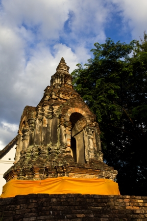 Old and Ancient Thai Pagoda with Blue Sky in the Background. photo