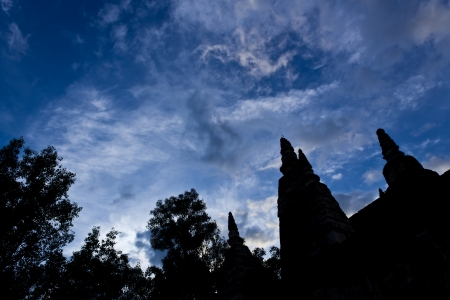 Silhouette of Ancient Pagoda with Blue and Cloudy Sky in Background. photo