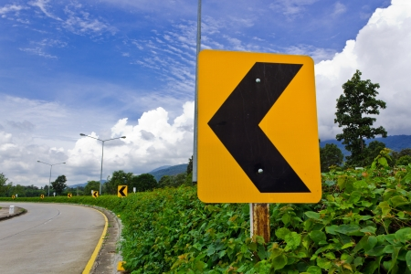 Road Signs warn Drivers for Ahead Dangerous Curve. photo