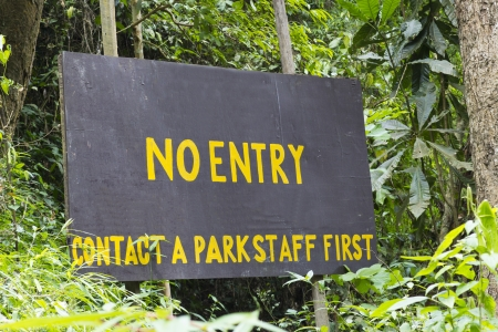 warns: Wooden Banner warns the tourist for the Danger Zone Entrance