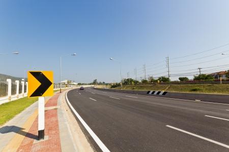 Road Sign warns Drivers to Beware Ahead Dangerous Curve. photo