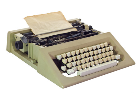Old Typewriter with paper sheet, isolated on white background photo