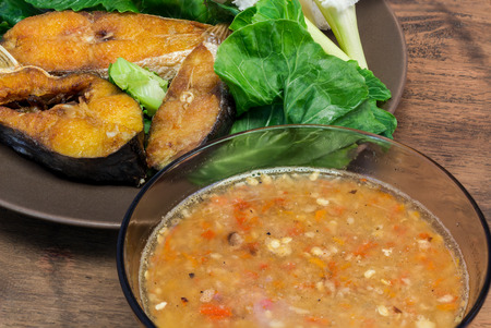 pronunciation: Fermented fish spicy dip (Nam Prik Pla-ra as Thai pronunciation) with fried fish, Thailand style of food. Stock Photo