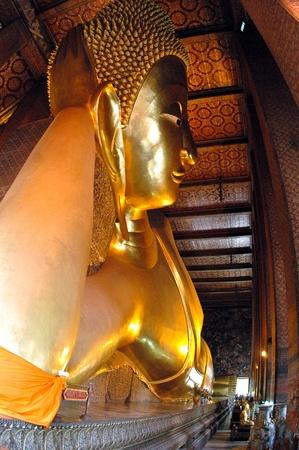 Golden reclining Buddha image photo
