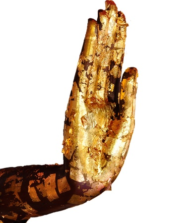 Buddha hand with gold leaf on white background photo