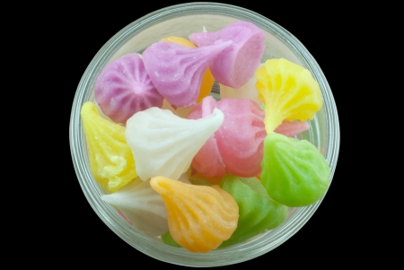 Colorful candy in a blow isolated in black background Stock Photo - 17001941